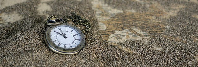 Pocket watch on beach